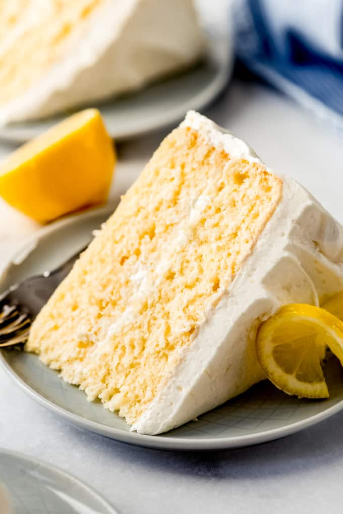 a slice of lemon layer cake on a plate