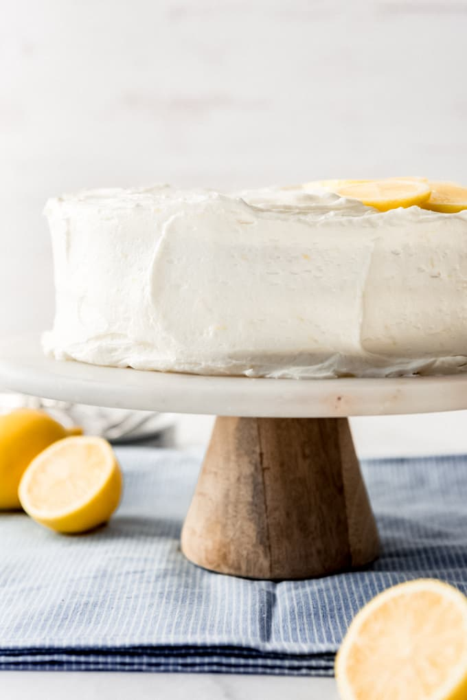 a lemon cake frosted with lemon buttercream frosting