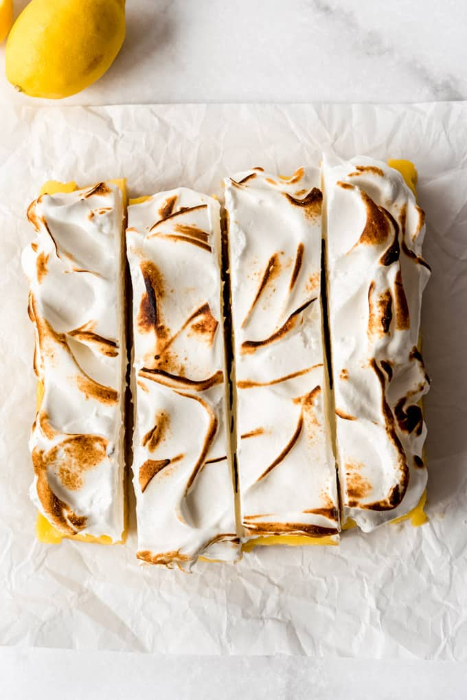 lemon meringue pie bars being sliced into squares