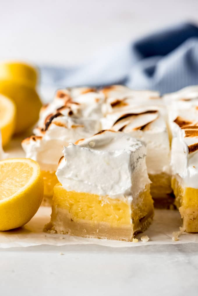 a square lemon bar topped with meringue