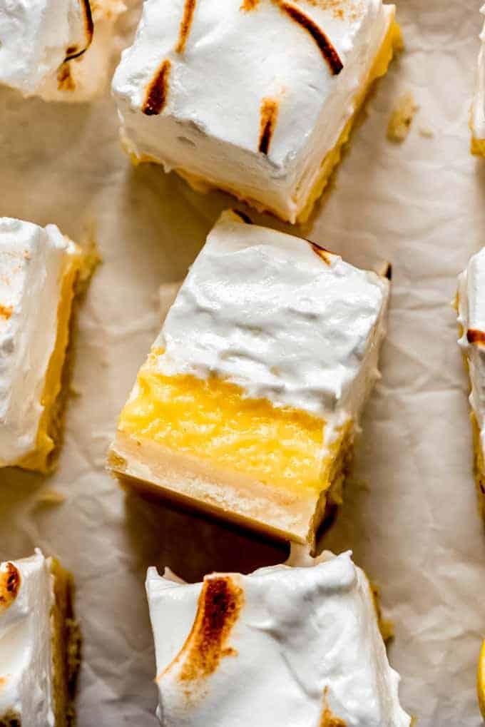 a close-up shot of a sliced lemon meringue pie bar
