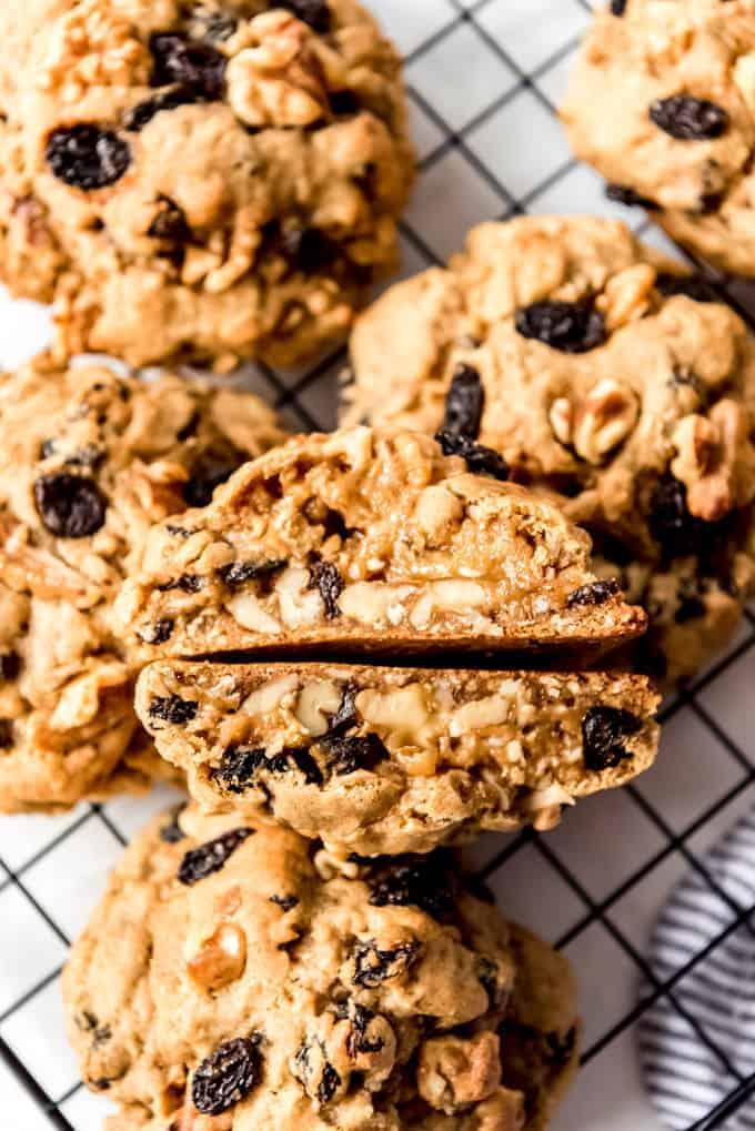 Overhead, Levain Bakery Oatmeal Raisin Cookies on wire rack with one cookie split in half