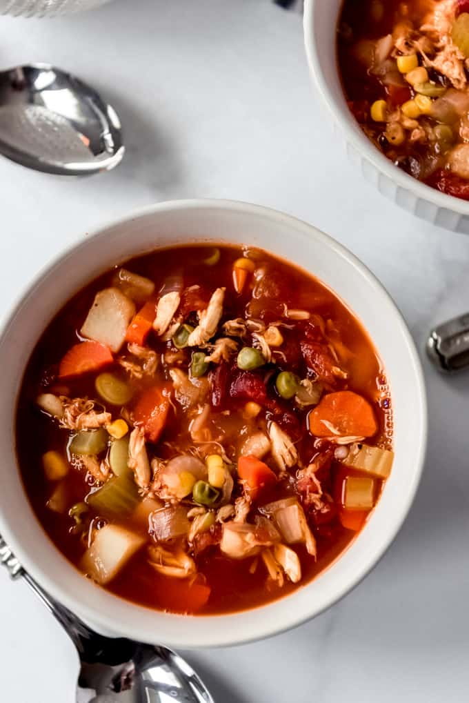 a bowl of crab soup with vegetables
