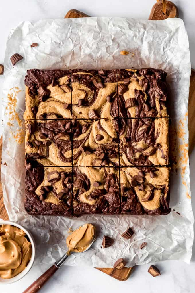 Square of Peanut Butter Swirl Brownies freshly cut on parchment paper, overhead shot