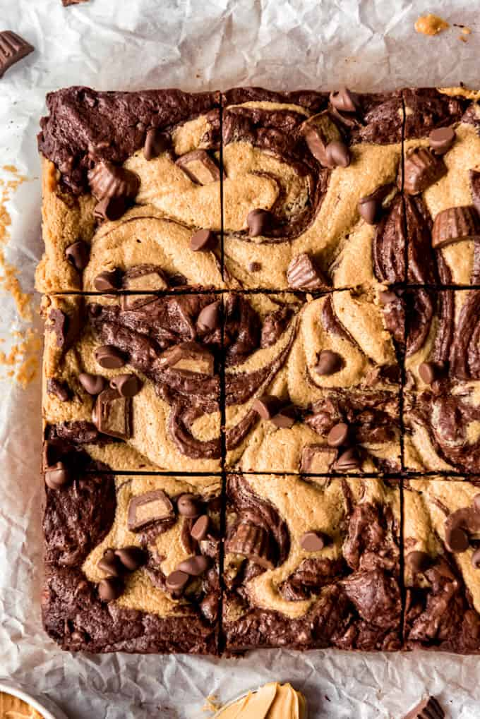 Square of Peanut Butter Swirl Brownies freshly cut on parchment paper, overhead shot off center