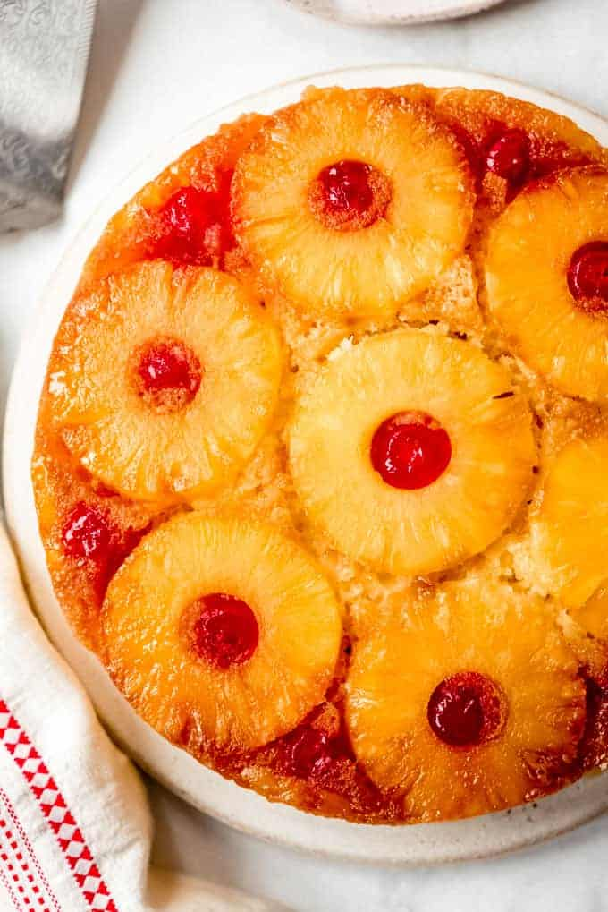 a from scratch pineapple upside down cake with pineapple and cherries