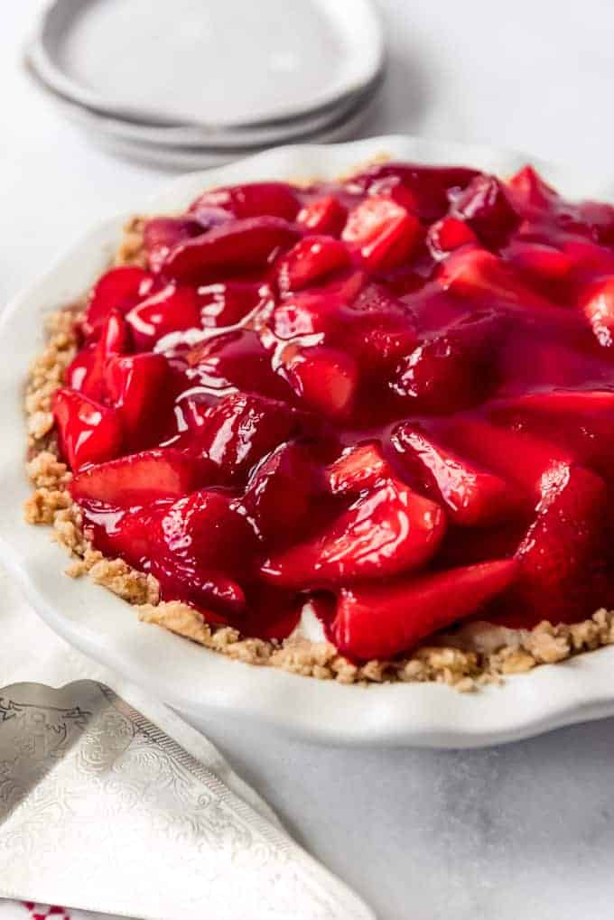 homemade strawberry cream cheese pie in a white pie plate