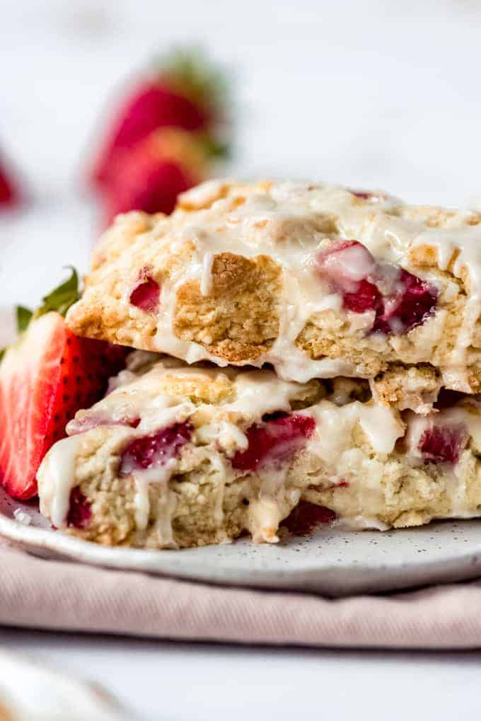 a close image of bits of strawberries in glazed scones