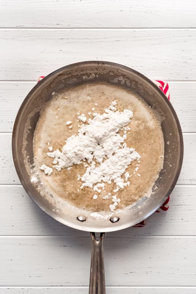 flour sprinkled over melted butter