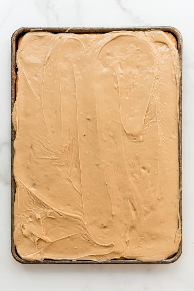 a banana sheet cake covered in penuche frosting