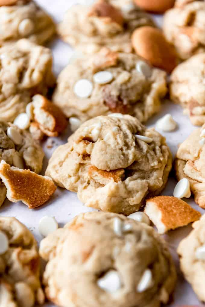 banana cookies close together with white chocolate chips and broken up Nilla Wafers