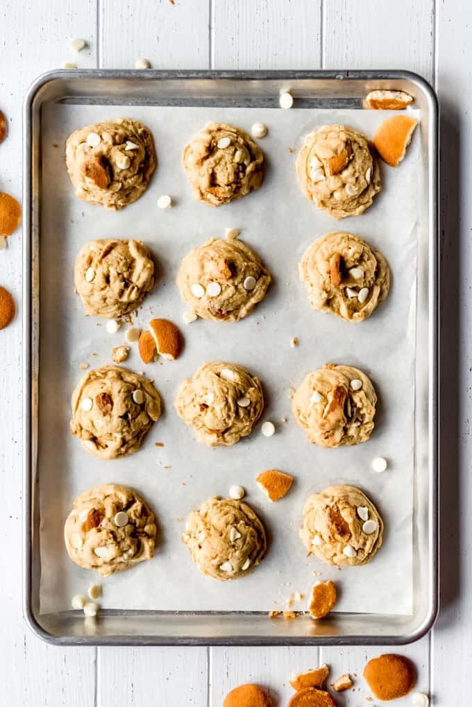 a dozen homemade banana cream pie cookies on a baking sheet lined with parchment paper