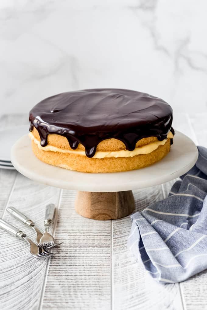 chocolate ganache on top of a boston cream pie