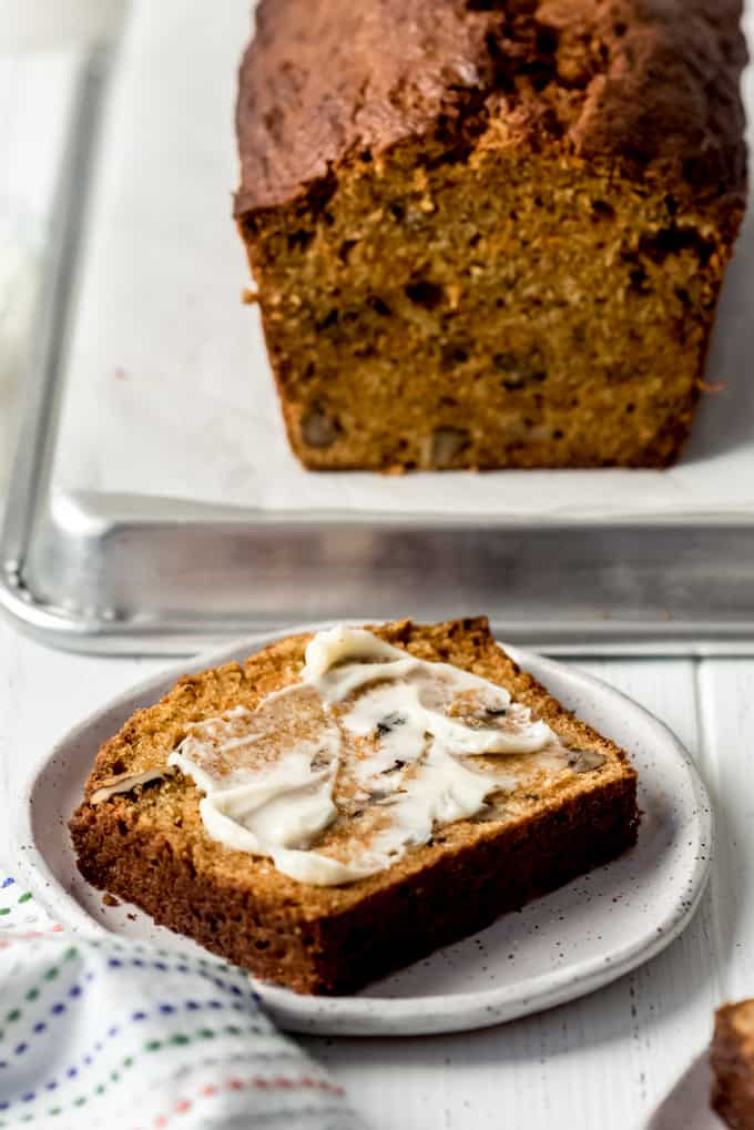 butter on a piece of homemade carrot bread