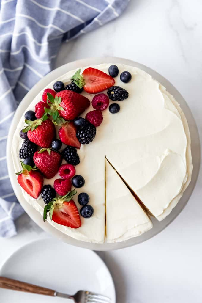 Chantilly Cake with a slice cut
