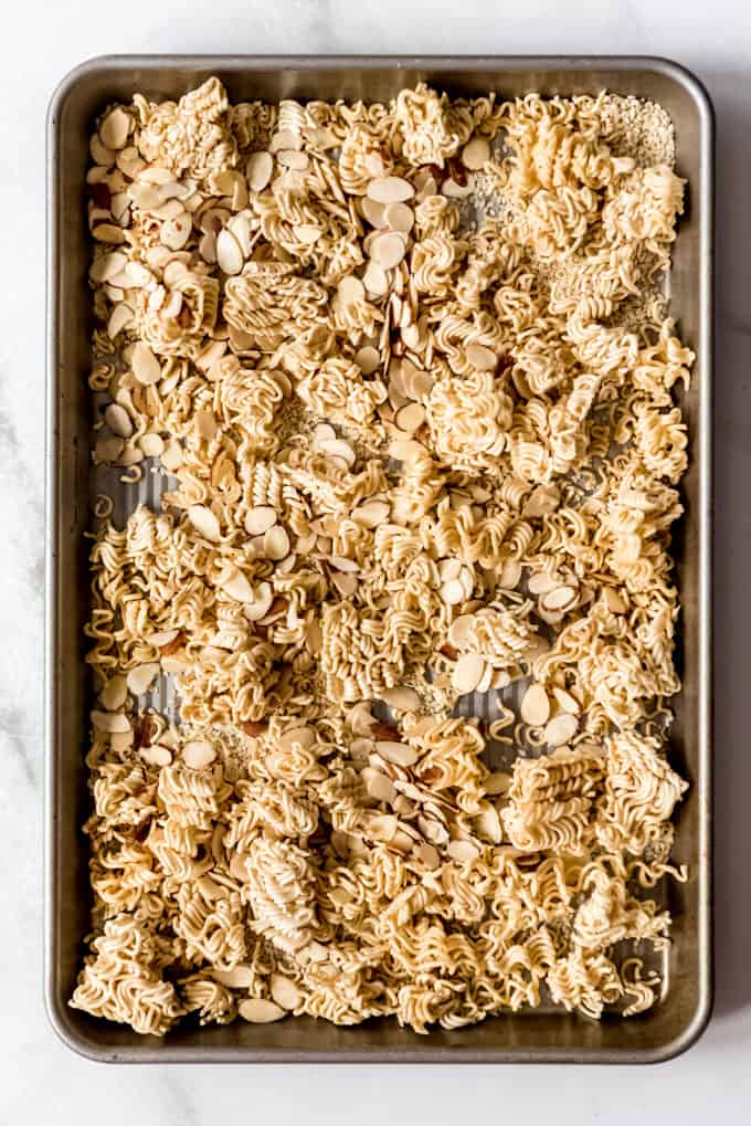 ramen noodle, sesame seed and slivered almond topping for chinese chicken salad on a baking sheet