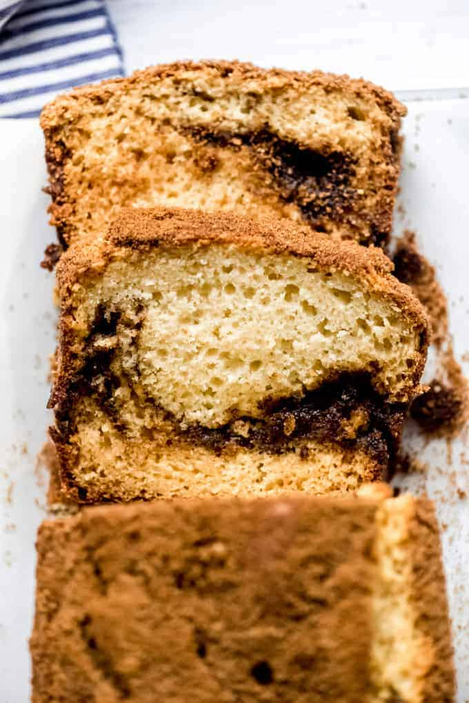 thick slices of cinnamon quick bread laying on a cutting surface