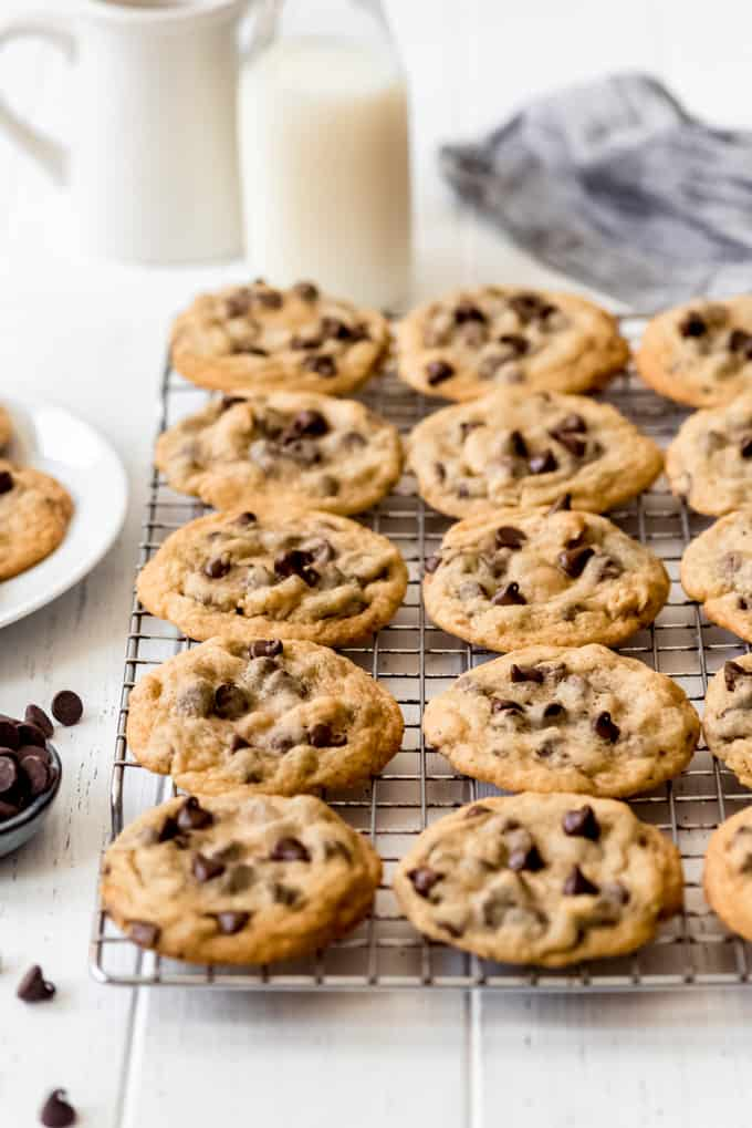 thin Nestle Tollhouse chocolate chip cookies on a wire cooling rack