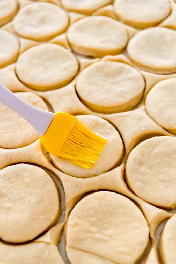 basting brush brushing butter on dough