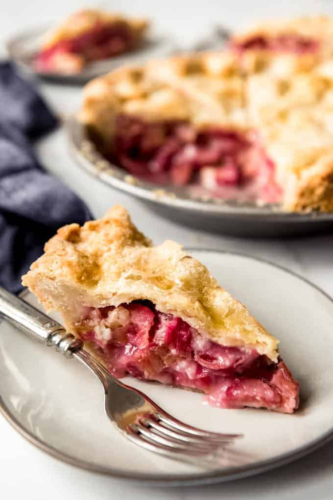 Slice of rhubarb pie on a plate with a fork