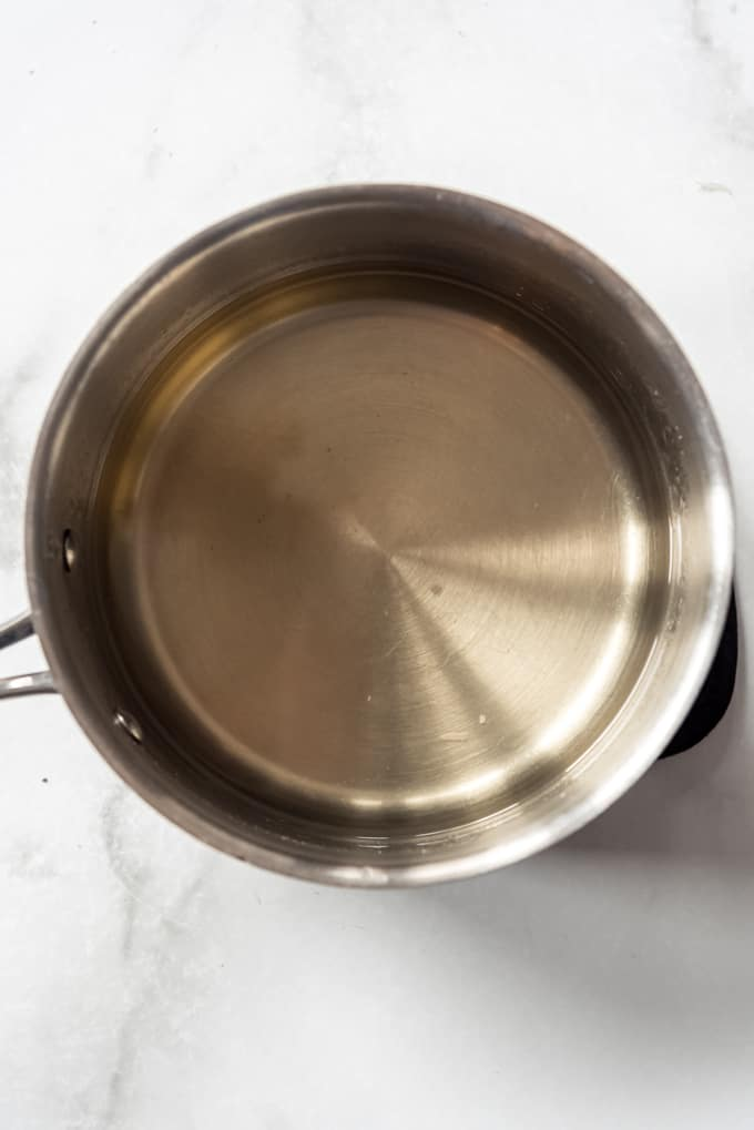 a small saucepan with simple syrup