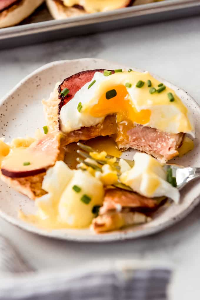 eggs benedict on plate with fork
