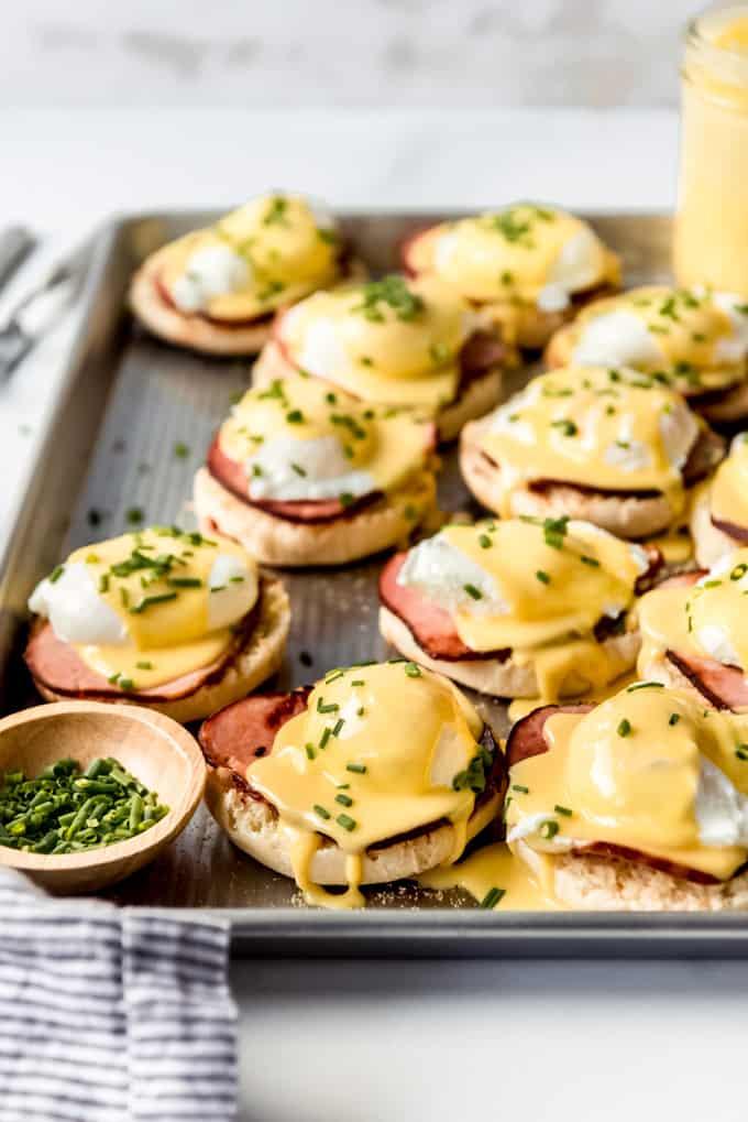 Assembled Eggs Benedict on baking sheet