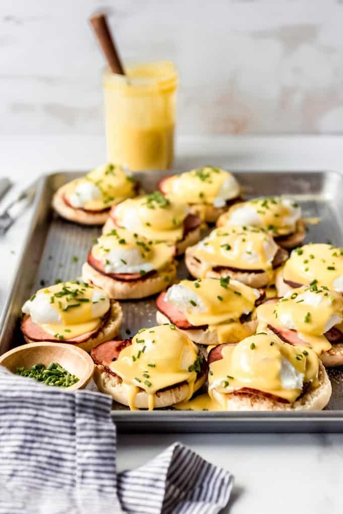 eggs benedict assembled on baking sheet