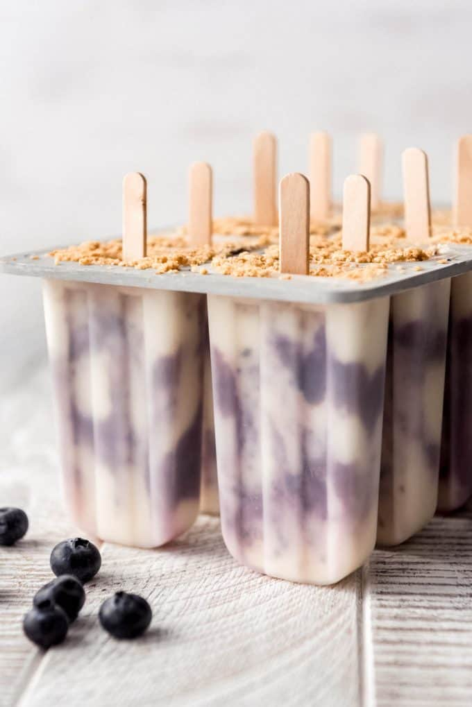 blueberry cheesecake popsicles in a popsicle mold