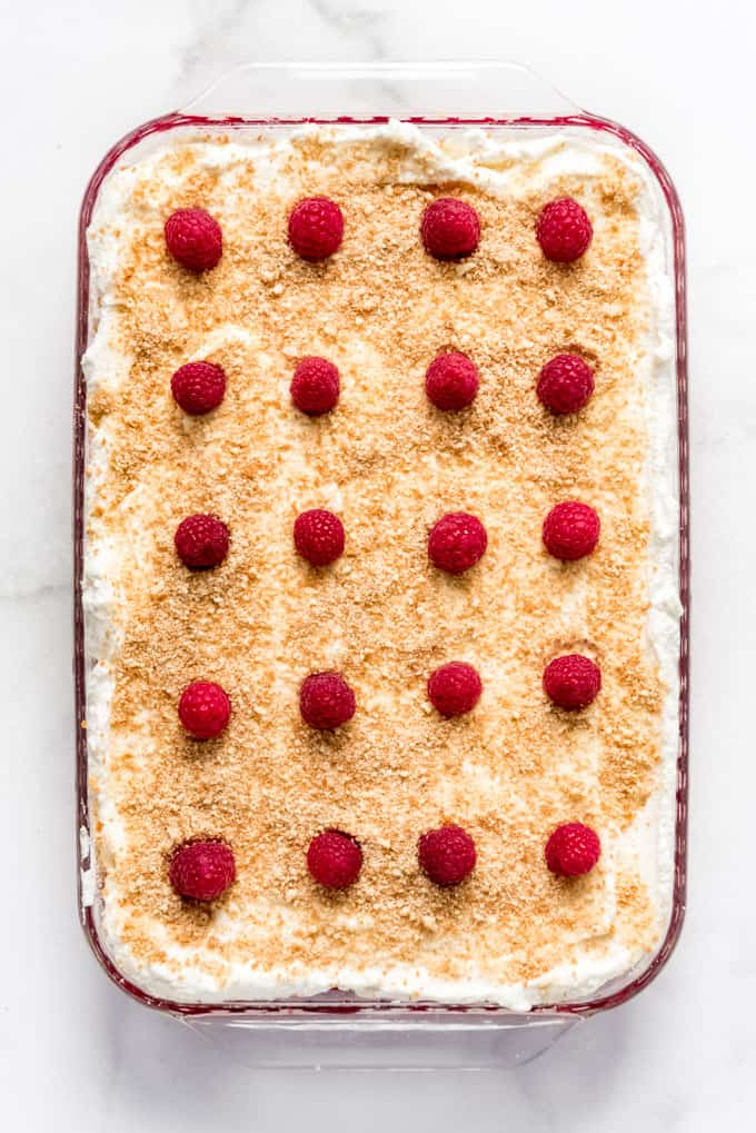 an image of raspberries decorating whipped cream topped jello