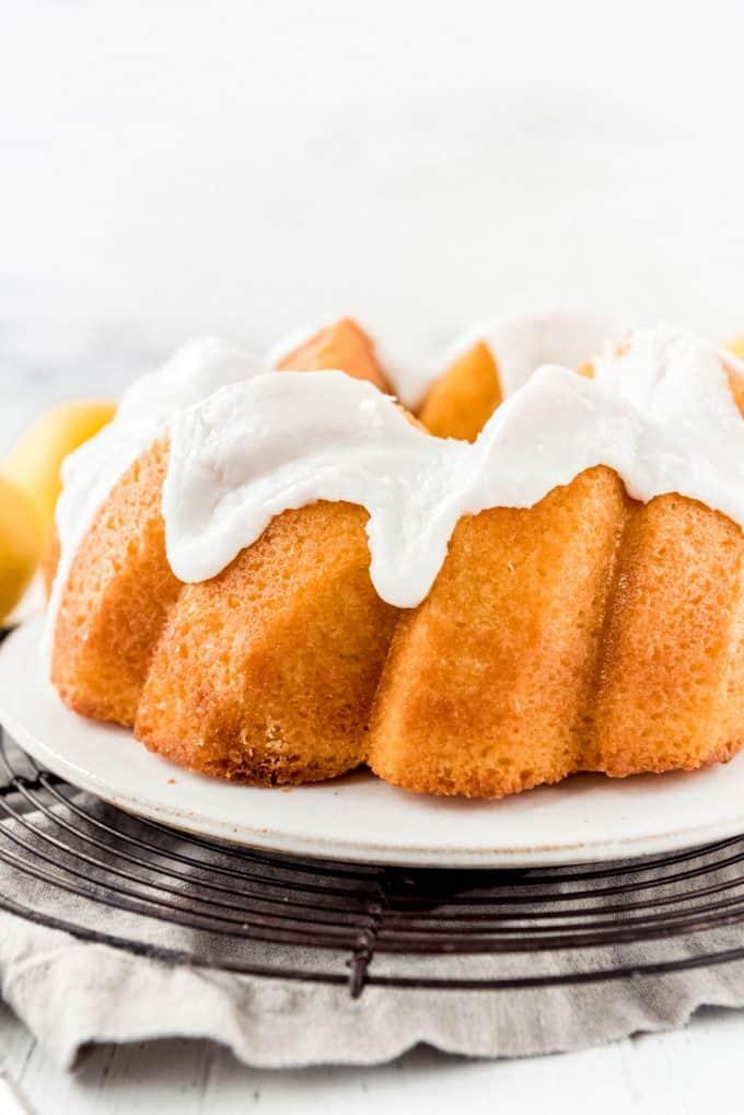 a close image of lemon bundt cake with lemon glaze