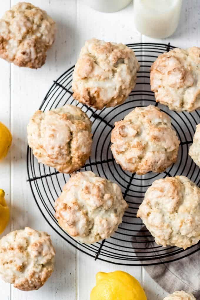 the glazed tops of lemon poppy seed muffins on a round wire cooling rack