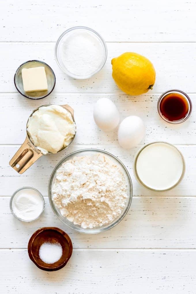 lemon ricotta pancake ingredients in separate bowls on a white surface