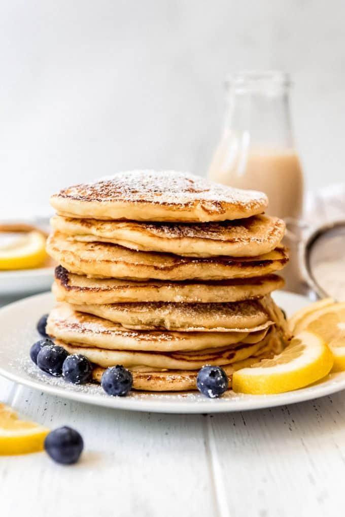 a tall stack of lemon ricotta pancakes