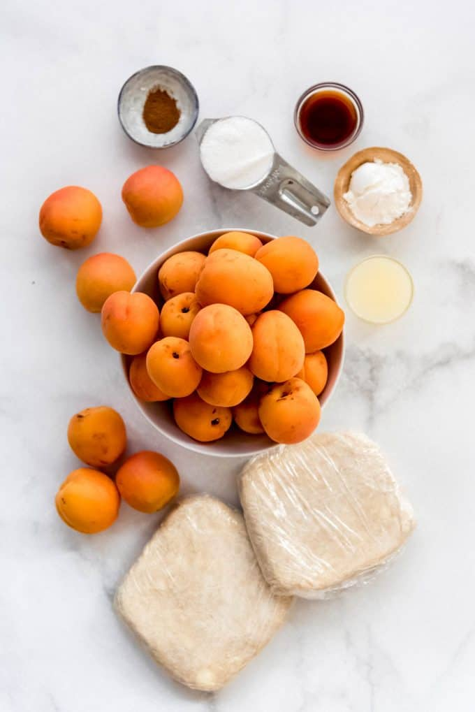 apricot pie ingredients on a marble surface