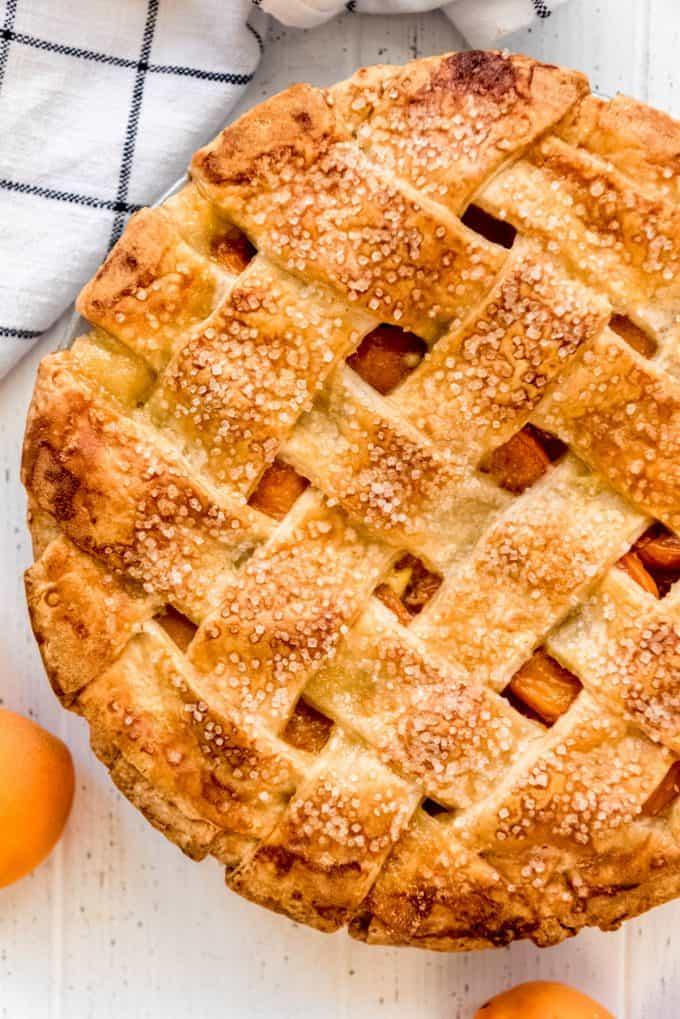 a lattice pie crust sprinkled with coarse sugar