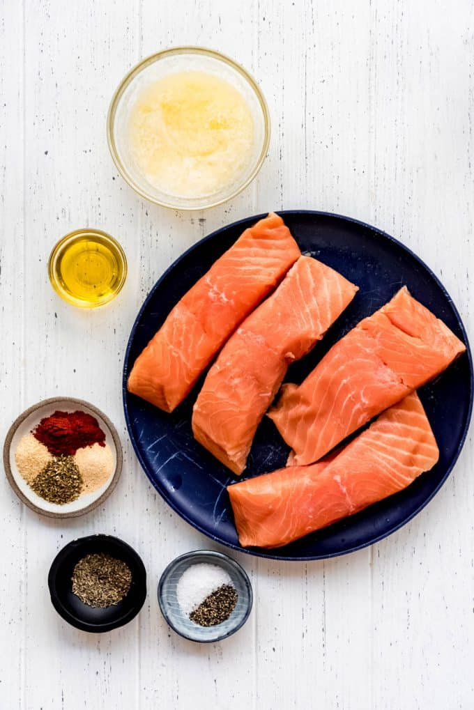butter, olive oil, spices, and salmon fillets