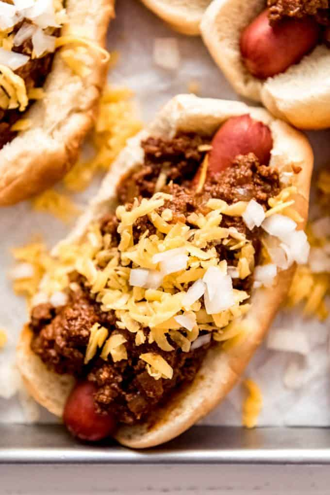 Coney Dog topped with meat sauce cheese and onions