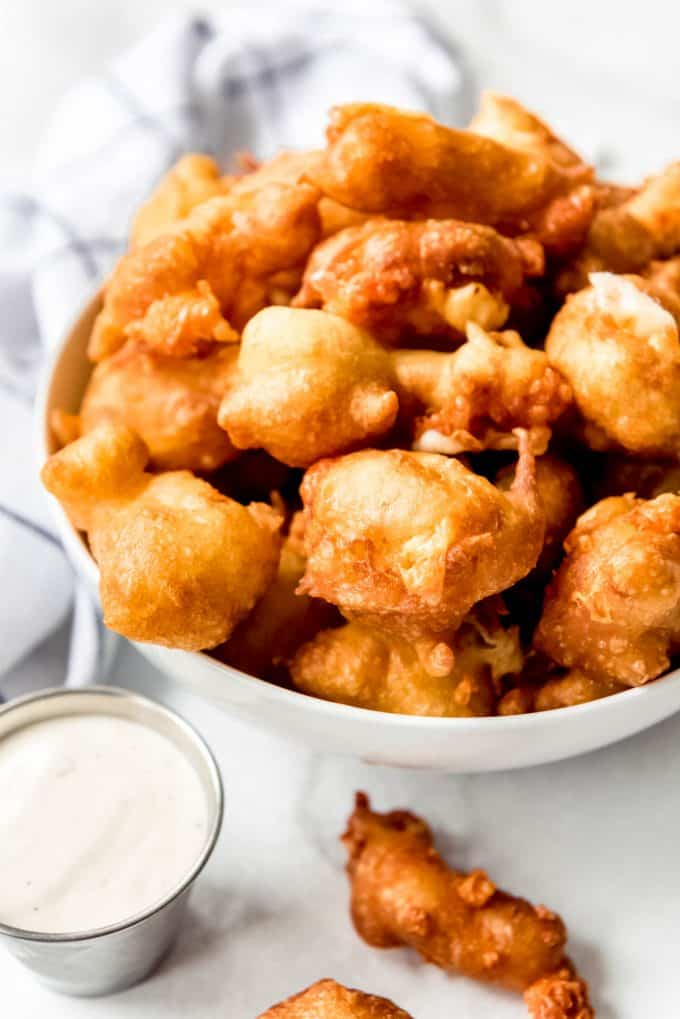 golden brown fried cheese curds in a white bowl
