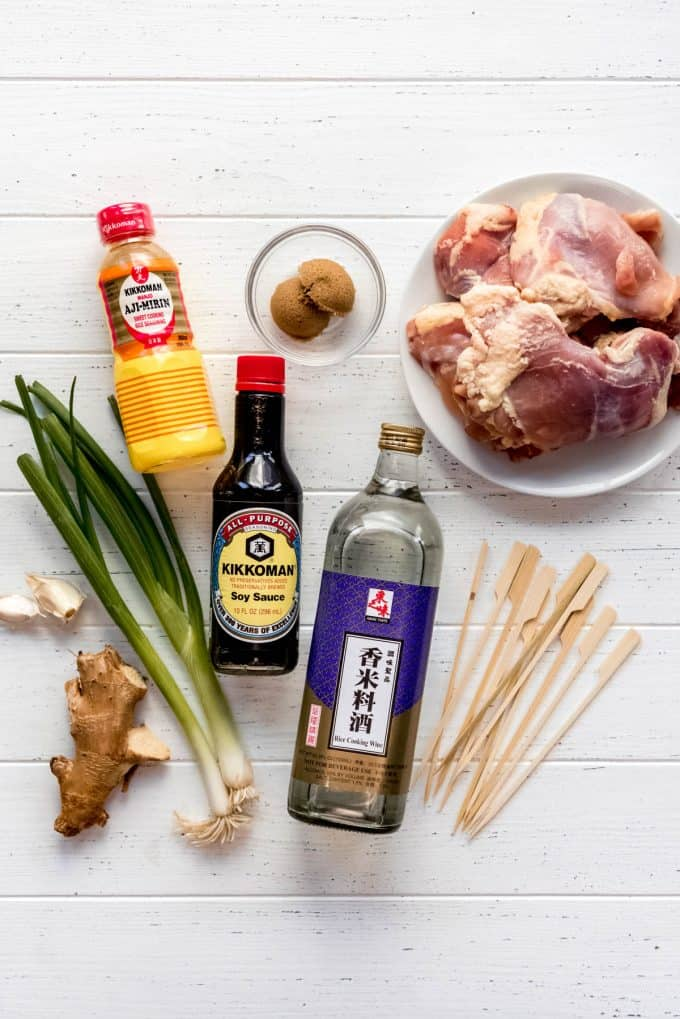 ingredients for yakitori negima on a white wooden surface
