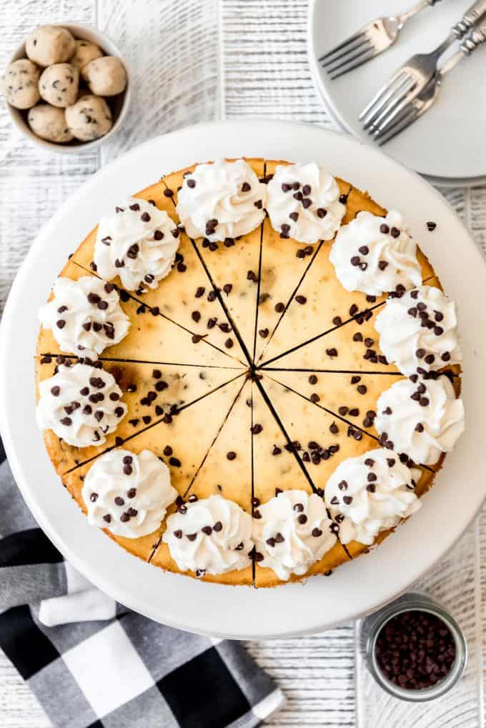 an overhead image of cheesecake decorated with whipped cream and mini chocolate chips