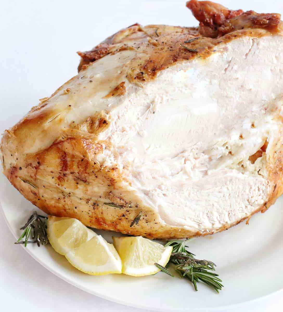Cooked turkey breast with a slice cut out