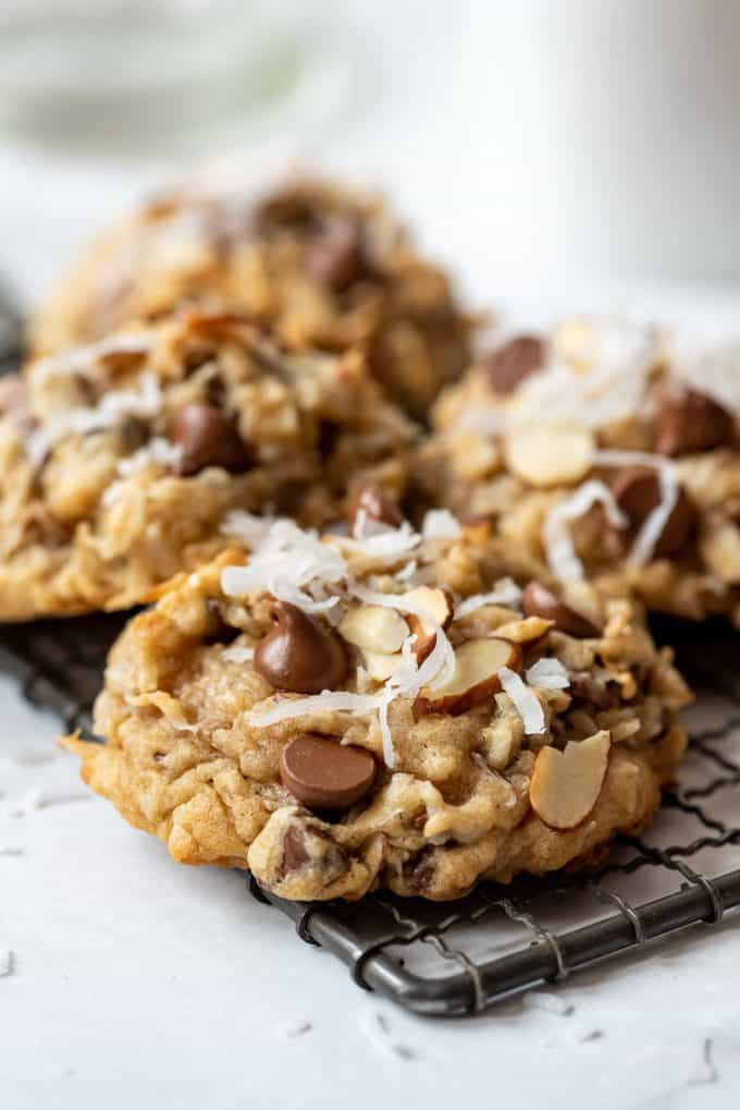 a close image of a cookie made with milk chocolate chips, slivered almonds, and shredded sweetened coconut