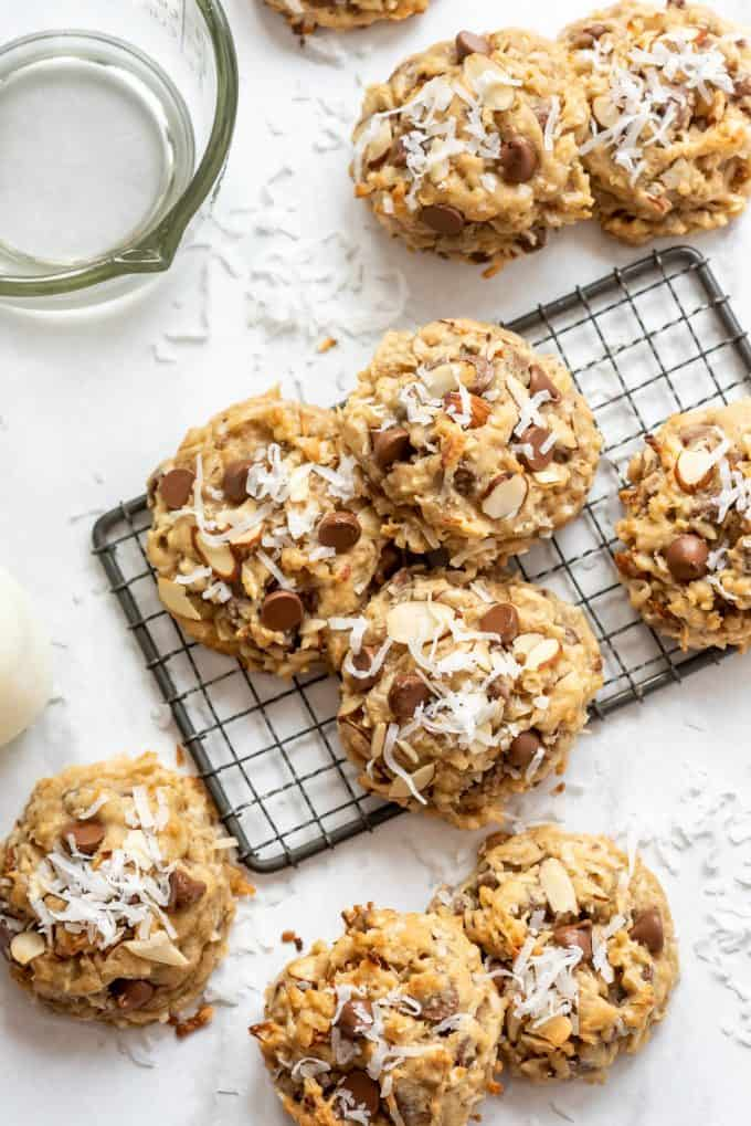 an overhead image of almond joy cookies sprinkled with shredded coconut