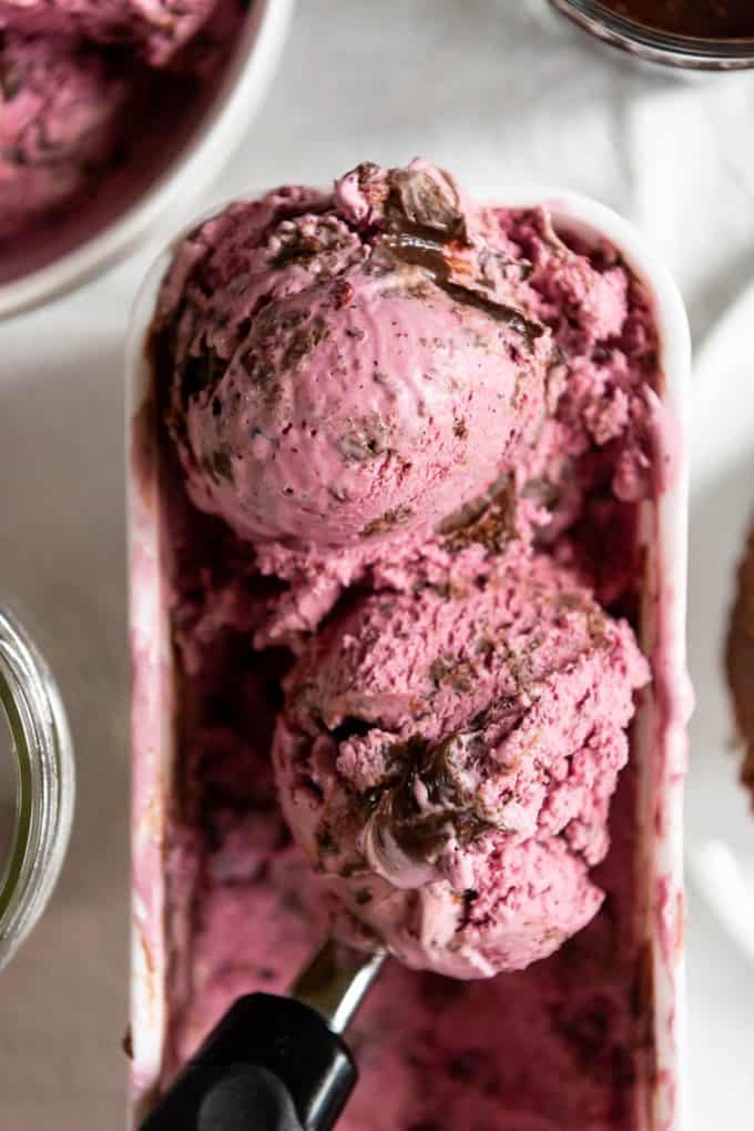 two scoops of huckleberry ice cream with brownie chunks and hot fudge swirls