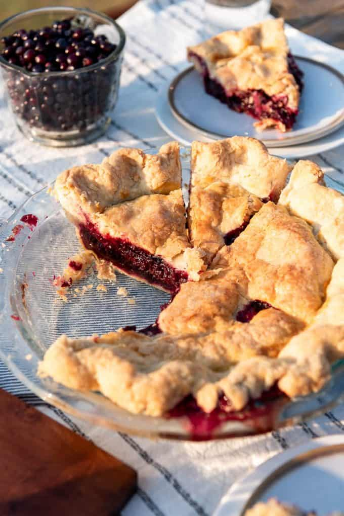 a huckleberry pie with some slices removed