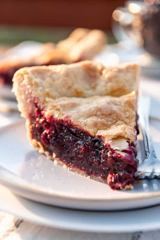 a slice of huckleberry pie on a plate