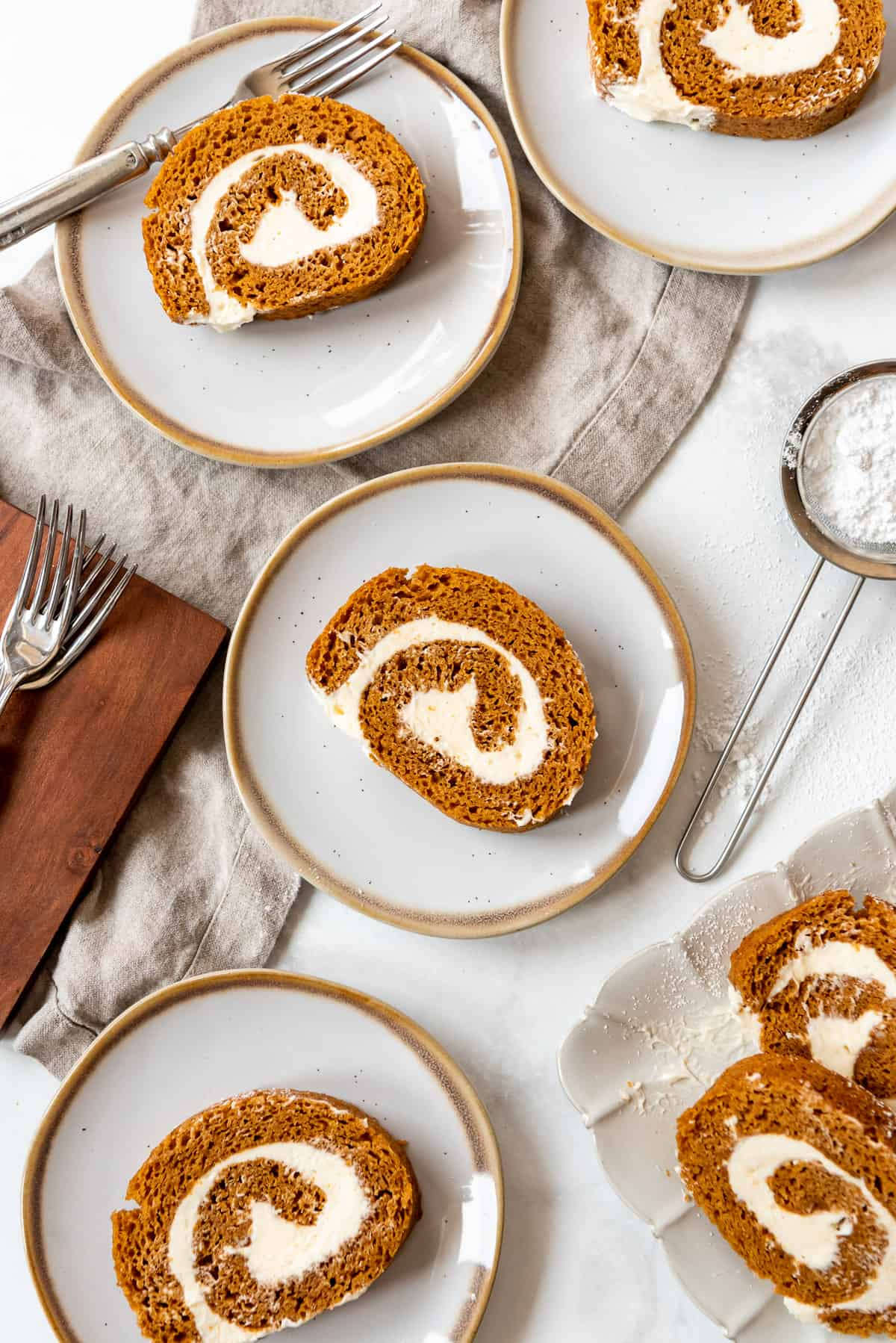 individual slices of homemade pumpkin cake roll on plates