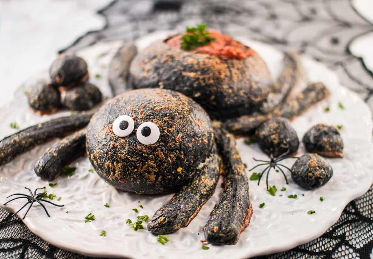 A spider bread bowl with sprinkle eyes.