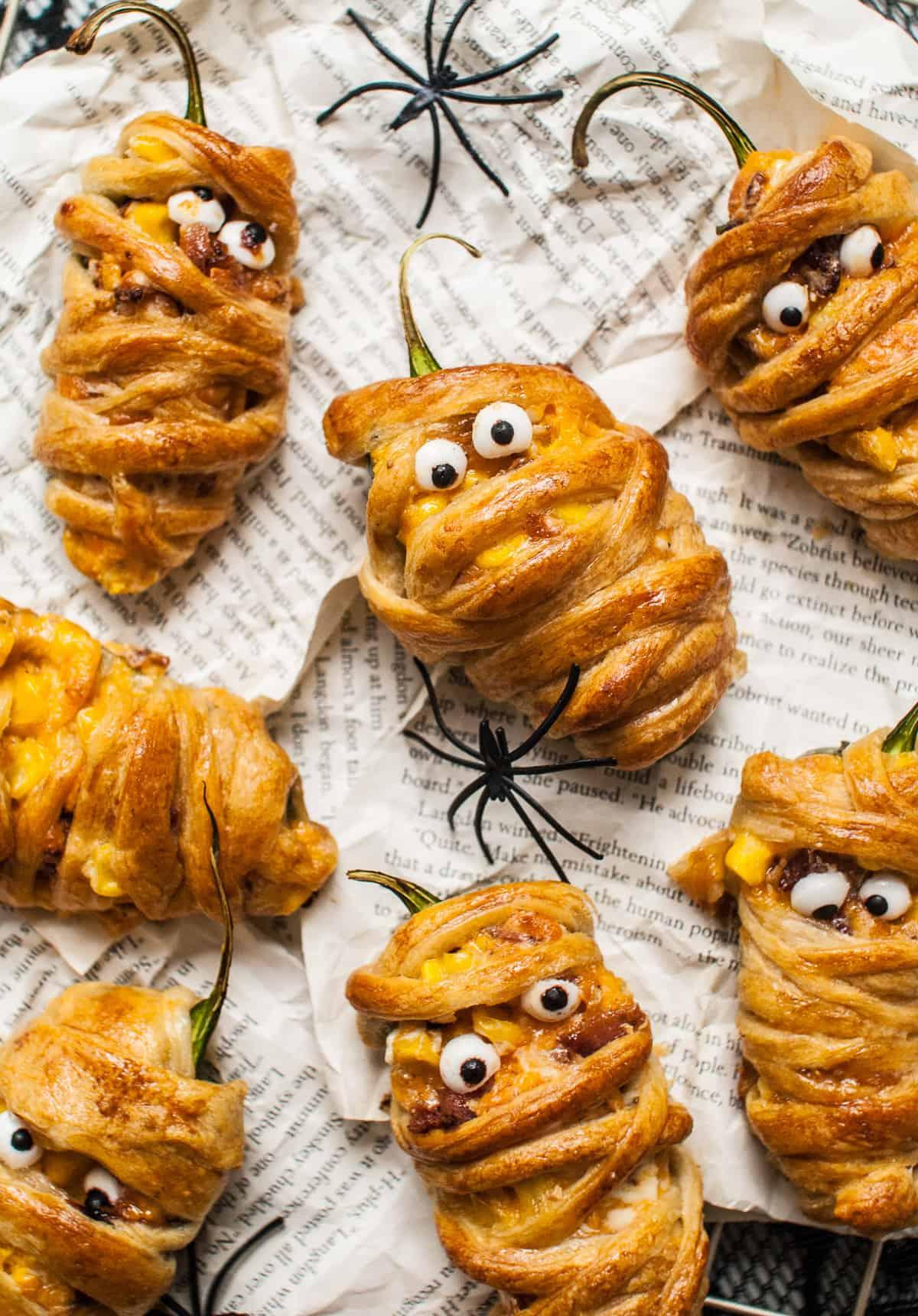 Cute Halloween savory appetizers that look like mummies.